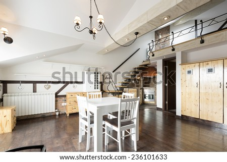 Kitchen and dining area in specious apartment - stock photo