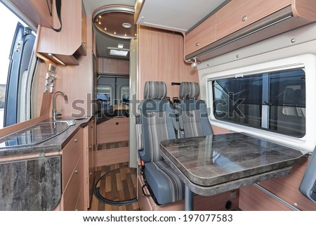 Kitchen and dining table in camping van - stock photo