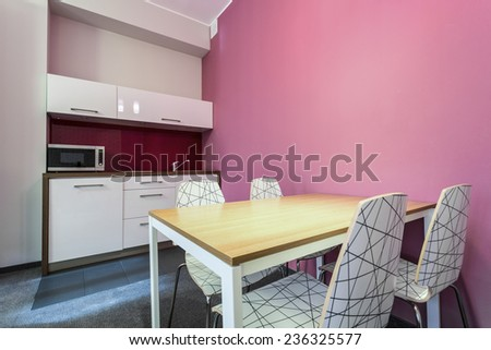 Kitchen and dinning room with rose wall - stock photo