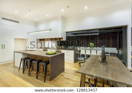 Kitchen and entertainment area in luxury home - stock photo