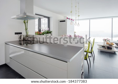 kitchen and living room in contemporary house - stock photo
