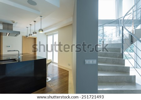 Kitchen and staircase in modern house - stock photo