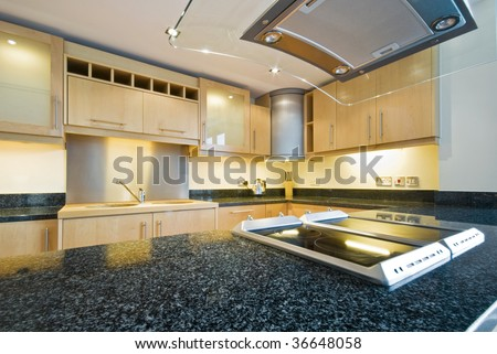 kitchen appliances with extractor fan and four ring hob - stock photo