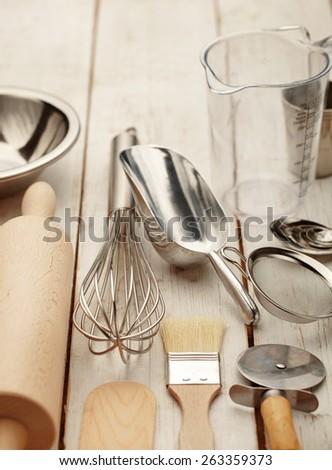 Kitchen baking utensils against white desk - stock photo