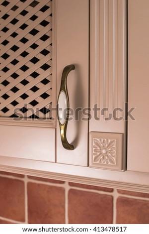 kitchen cabinet handle on - stock photo