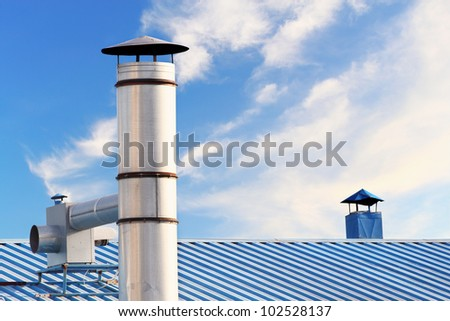 Kitchen chimney smoke and roof - stock photo