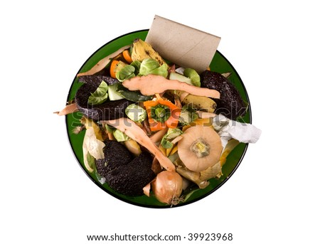 Kitchen compost in a glass green bowl - stock photo