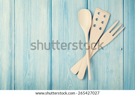 Kitchen cooking utensils over wooden table background. Top view with copy space. Retro toned - stock photo
