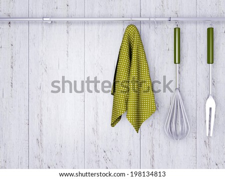 Kitchen cooking utensils. Steel spatulas, whisk and towel in front of rustic white wooden wall. - stock photo