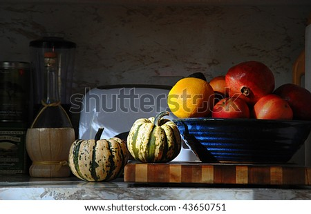 Kitchen Counter Still Life with veggies and fruit - stock photo