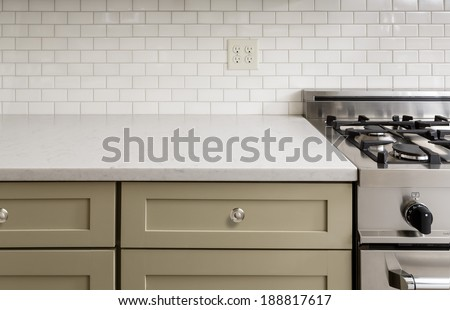 Kitchen Counter with Subway Tile, Stainless Steel oven stove, Shaker Cabinets - stock photo