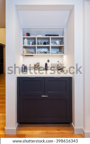 Kitchen desk area with drawers, cubbies and electronics charging station - stock photo