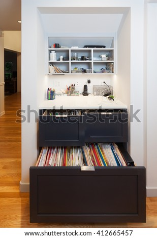 Kitchen desk area with drawers, file cabinet, cubbies and electronics charging station - stock photo