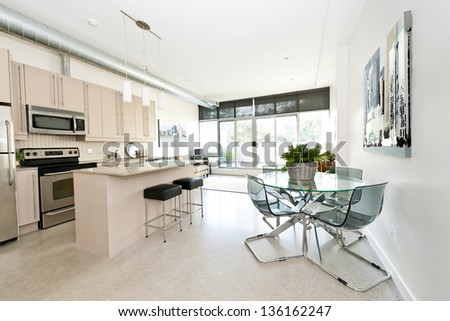 Kitchen, dining and living room of apartment - stock photo