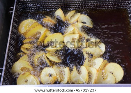 kitchen fried potatoes with oil - stock photo