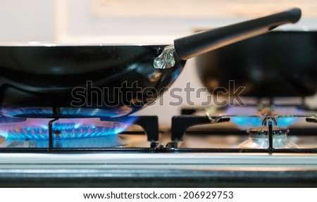 kitchen gas burner with blue flame - stock photo