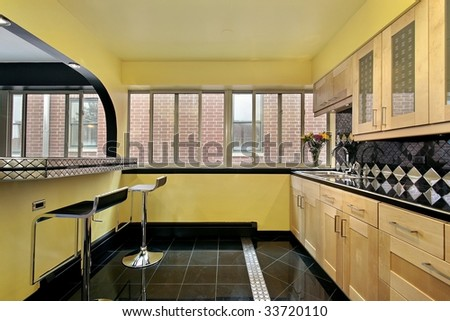 Kitchen in condo with yellow walls - stock photo