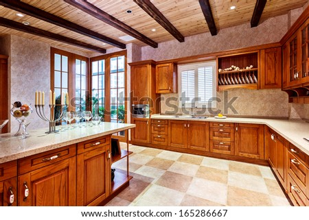 kitchen in luxury home with oak cabinets stock photo   Kitchen Cabinets Stock Photos, Images, & Pictures ...