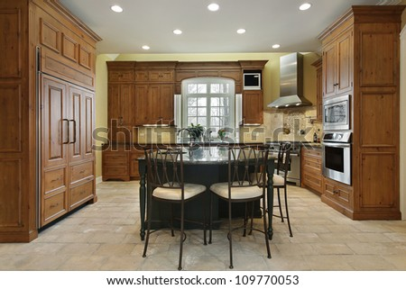 Kitchen in luxury home with center island - stock photo