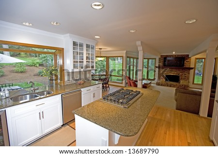 Kitchen in luxury home with view to outdoors - stock photo
