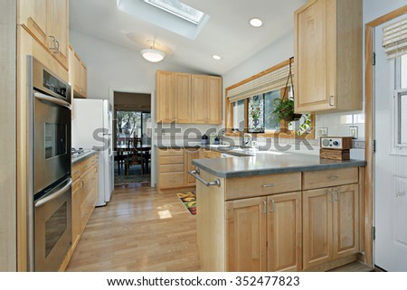 Kitchen in suburban home with skylight - stock photo