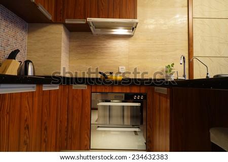 Kitchen interior in family house - stock photo