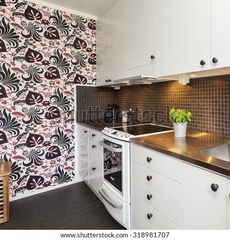 kitchen interior with modern wallpaper  - stock photo