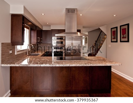 Kitchen interior with stainless steel appliances - stock photo