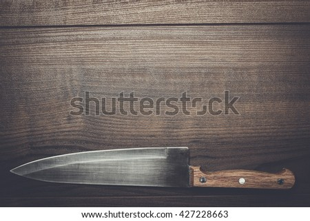 kitchen knife on the brown wooden table background - stock photo