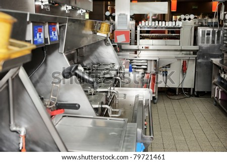 Kitchen of a fast food restaurant - stock photo