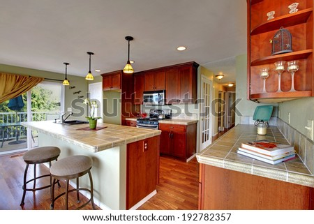 Kitchen room with walkout deck. View of kitchen island with built-in sink. - stock photo
