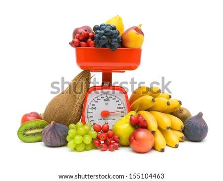 Kitchen scales and fresh ripe fruits isolated on white background close-up. horizontal photo. - stock photo