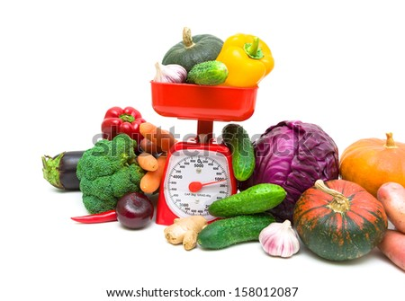 Kitchen scales and fresh vegetables on white background close-up. horizontal photo. - stock photo