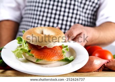 kitchen scene with freshly prepared bagel - stock photo