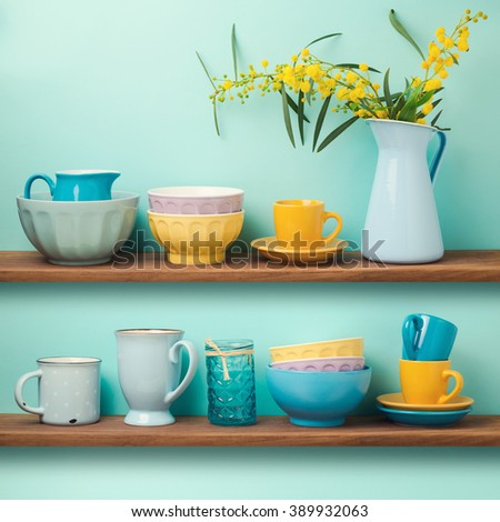 Kitchen shelf with cups and dishes - stock photo