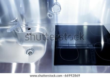 Kitchen silver sink and vitroceramic stove hob modern decoration - stock photo