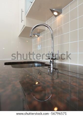 Kitchen sink with granite worktop - stock photo