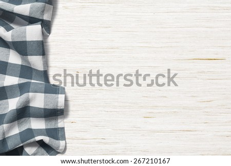 kitchen table background with picnic cloth - stock photo