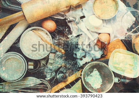 Kitchen Table Top Preparation Baking Process Wooden Metal Dishes Ware Ingredient Grocery Different Stuff Top View Toned - stock photo