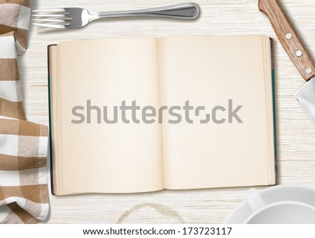 kitchen table with open book or copybook as a background for cooking recipe - stock photo