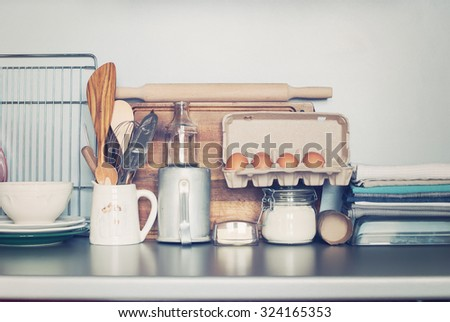 Kitchen Tabletop with Rustic Dishes, Table ware, Fresh Grocery and other Different Stuff  - stock photo