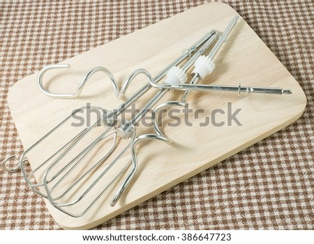 Kitchen Tools and Equipment, Four Modern Electric Mixer or Electric Whisk on Wooden Cutting Board. - stock photo