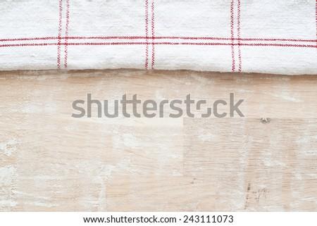 kitchen towel and flour - stock photo