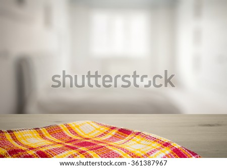 kitchen towel on old wooden desk in the bedroom - stock photo