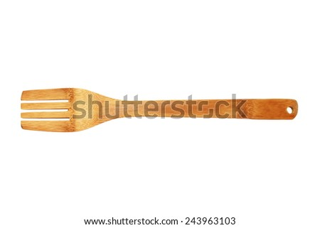 kitchen traditional utensil, wooden fork isolated over white background - stock photo