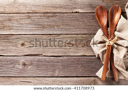 Kitchen utensil over wooden table background. View from above with copy space - stock photo