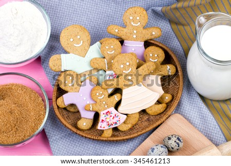 Kitchen utensils and ingredients for christmas homemade gingerbread cookies on wooden table. - stock photo