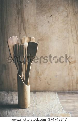 Kitchen utensils on wooden table. Retro filter. - stock photo