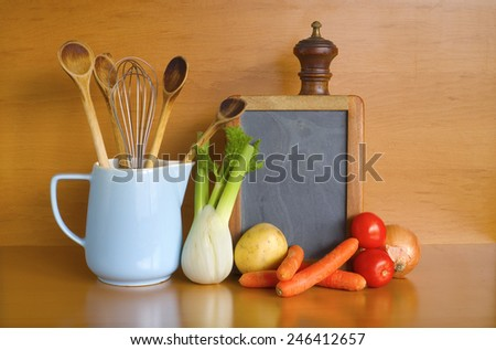 kitchen utensils,vegetables,blackboard for recipes, free copy space - stock photo