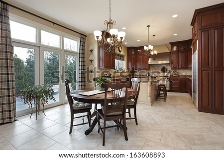 Kitchen with center island and eating area - stock photo
